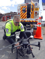 Travis White, Utah Department of Transportation, Highway Incident Management Team, holds a their drone at a drone demo Monday, May 20, 2019, in Park City, Utah. In Utah, drones are hovering near avalanches to watch roaring snow. In North Carolina, they're searching for the nests of endangered birds. In Kansas, they could soon be identifying sick cows through heat signatures. Public transportation agencies are using drones in nearly every state, according to a new survey released on Monday, May 20, 2019 by the American Association of State Highway and Transportation Officials. (AP Photo/Rick Bowmer)