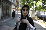 In this Friday, May 17, 2019 photo, civil servant Masumeh Izadpanah speaks during an interview in downtown Tehran, Iran.