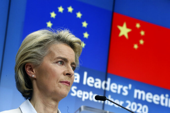 European Commission President Ursula von der Leyen during an online press conference with European Council President Charles Michel and German Chancellor Angela Merkel following an EU-China virtual summit at the European Council building in Brussels, Monday, Sept. 14, 2020. Michel, Merkel and Von der Leyen had talks in a videoconference with China's President Xi Jinping. (Yves Herman/Pool Photo via AP)