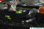 Michigan State forward Gabe Brown hangs from the rim after a dunk during the second half of an NCAA college basketball game against Wisconsin, Friday, Jan. 17, 2020, in East Lansing, Mich. (AP Photo/Carlos Osorio)