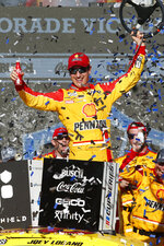 Joey Logano celebrates in Victory Lane after winning a NASCAR Cup Series auto race at Phoenix Raceway, Sunday, March 8, 2020, in Avondale, Ariz. (AP Photo/Ralph Freso)