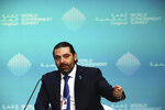Lebanese Prime Minister Saad Hariri speaks during the World Government Summit in Dubai, United Arab Emirates, Sunday, Feb. 10, 2019. At the summit on Sunday, Hariri urged investment in Lebanon as it faces an economic crisis that has seen thousands of people laid off and one of the highest public debts in the world. (AP Photo/Jon Gambrell)