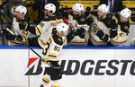 Boston Bruins center Karson Kuhlman (83) is congratulated after scoring a goal against the St. Louis Blues during the third period of Game 6 of the NHL hockey Stanley Cup Final Sunday, June 9, 2019, in St. Louis. (AP Photo/Scott Kane)
