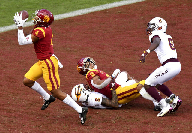 Arizona State wide receiver Bru McCoy (4) catches a pass for a touchdown that was tipped by teammate wide receiver Amon-Ra St. Brown (8) as Arizona State defensive back DeAndre Pierce (2) and defensive back Timarcus Davis (6) during the second half of an NCAA college football game Los Angeles, Saturday, Nov. 7, 2020. (Keith Birmingham/The Orange County Register via AP)