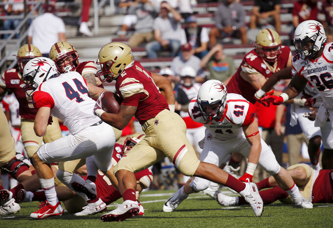 Boston College running back AJ Dillon (2) rushes past Richmond defenders during the first half of an NCAA college football game, Saturday, Sept. 7, 2019, in Boston. (AP Photo/Mary Schwalm)