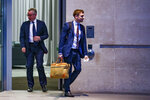 British Conservative party leadership contender Michael Gove, left, leaves BBC House after a TV debate in central London Tuesday, June 18, 2019. (AP Photo/Vudi Xhymshiti)