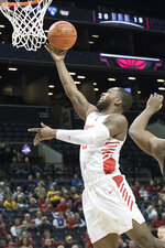 Dayton guard Trey Landers goes to the basket during the first half of an NCAA college basketball game against the Saint Louis in the Atlantic 10 Conference tournament, Friday, March 15, 2019, in New York. (AP Photo/Mary Altaffer)