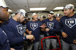 Tampa Bay Rays manager Kevin Cash, center, talks with players as they celebrate after defeating the Oakland Athletics in an American League wild-card baseball game in Oakland, Calif., Wednesday, Oct. 2, 2019. (AP Photo/Jeff Chiu)