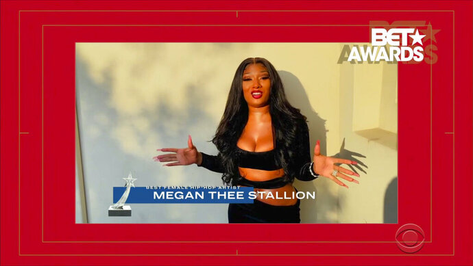 In this video grab issued Sunday, June 28, 2020, by BET, Megan Thee Stallion accepts the award for best female hip-hop artist during the BET Awards. (BET via AP)