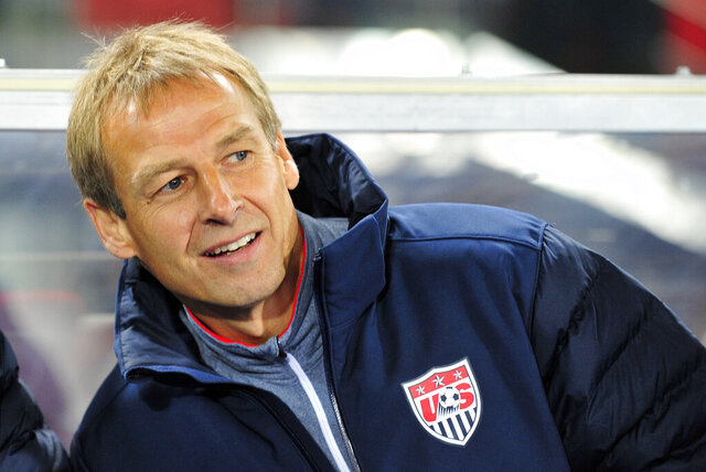 FILE - In this Tuesday, Nov. 19, 2013 file photo, US national soccer team coach Juergen Klinsmann watch the friendly soccer match between Austria and United States in Vienna, Austria. Klinsmann has been named the new coach of soccer club Hertha BSC Berlin after Ante Covic was fired with the team 15th in the German Bundesliga. (AP Photo/Hans Punz)