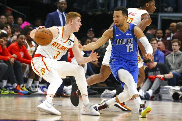 Atlanta Hawks guard Kevin Huerter (3) is guarded by Dallas Mavericks guard Jalen Brunson (13) in the first half during an NBA basketball game Saturday, Feb. 1, 2020 in Dallas. (AP Photo/Richard W. Rodriguez)