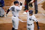 New York Yankees' Aaron Judge, left, celebrates with Gio Urshela after Urshela hit a two-run home run during the first inning of the team's baseball game against the Tampa Bay Rays on Wednesday, June 2, 2021, in New York. (AP Photo/Frank Franklin II)