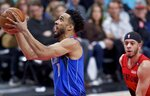Dallas Mavericks guard Courtney Lee, left, shoots in front of Portland Trail Blazers guard Seth Curry during the first half of an NBA basketball game in Portland, Ore., Wednesday, March 20, 2019. (AP Photo/Craig Mitchelldyer)