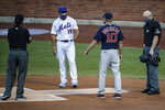 New York Mets manager Luis Rojas (19) and Boston Red Sox manager Ron Roenicke (10) maintain social distance during a meeting at home plate before a baseball game, Wednesday, July 29, 2020, in New York. (AP Photo/John Minchillo)