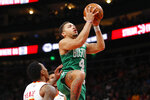Boston Celtics guard Carsen Edwards (4) goes up for the shot in the first half of an NBA basketball game against the Atlanta Hawks on Monday, Feb. 3, 2020, in Atlanta. (AP Photo/Todd Kirkland)