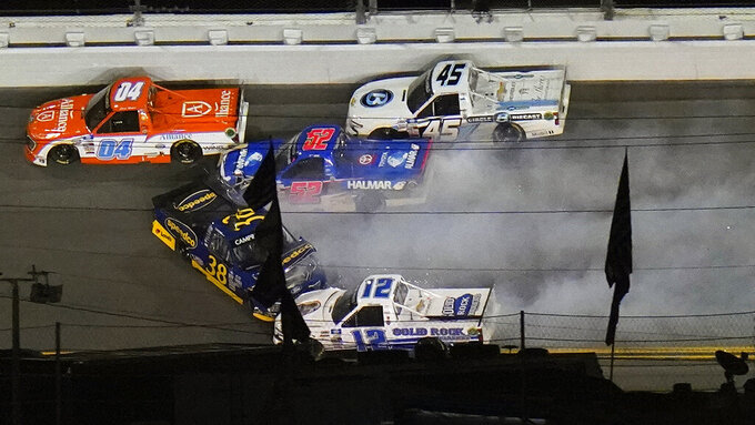 Todd Gilliland (38) hits Stewart Friesen (52) and Tate Fogleman (12) during a a crash in the NASCAR Camping World Truck Series auto race Friday, Feb. 12, 2021, at the Daytona International Speedway in Daytona Beach, Fla. (AP Photo/Chris O'Meara)