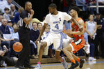 North Carolina guard Brandon Robinson (4) chases the ball with Miami guard Isaiah Wong (2) during the second half of an NCAA college basketball game in Chapel Hill, N.C., Saturday, Jan. 25, 2020. (AP Photo/Gerry Broome)