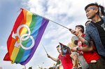 FILE - In this Dec. 10, 2016, file photo, supporters of LGBT and human rights wave rainbow flags during a rally supporting a proposal to allow same-sex marriage in Taipei, Taiwan, on the World Human Rights Day. Taiwanese legislators are scheduled to decide Friday on legalizing same-sex marriage, marking a potential first in Asia. (AP Photo/Chiang Ying-ying, File)