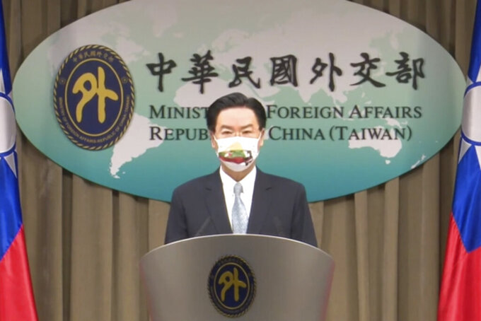 FILE - In this July 20, 2021, file image taken from a video footage run by Taiwan's Ministry of Foreign Affairs via AP Video, Taiwan Foreign Minister Joseph Wu, speaks about exchanging representative offices with Lithuania during a press briefing in Taipei, Taiwan. China on Tuesday, Aug. 10, 2021, recalled its ambassador to Lithuania and expelled the Baltic nation's top representative to Beijing over the country's decision to allow self-governing Taiwan to open an office in Lithuania under its own name. (Taiwan's Ministry of Foreign Affairs AP Video, File)