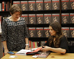 "Danica Patrick, right, autographs her new book for Julie Grunwald during a book signing in Charlotte, N.C., Thursday, Jan. 4, 2018. The transition from race car driver to businesswoman was swift, and Patrick is now adjusting to a new celebrity life that doesn't include driving cars. She hawked her new book all last week, and held her first organized book signing. As for her plans to drive the ""Danica Double"" and race the Daytona 500 and Indianapolis 500? Well, it's not coming together as quickly as she'd like. (AP Photo/Chuck Burton)"
