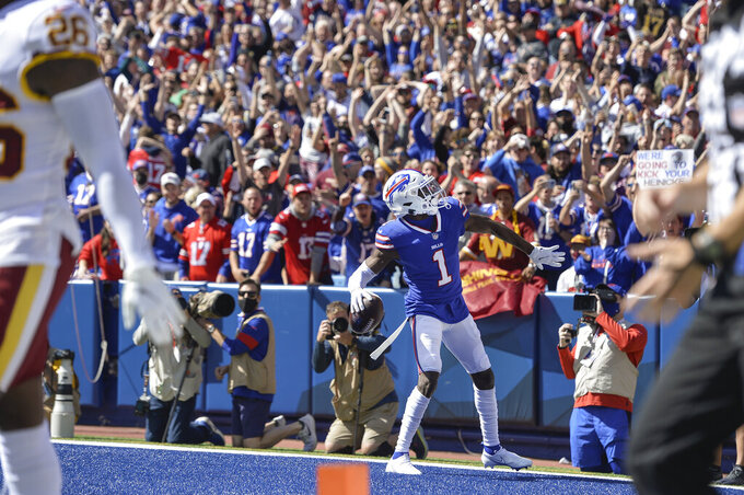Buffalo Bills wide receiver Emmanuel Sanders (1) gestures to fans after making a catch in front of Washington Football Team's Landon Collins (26) for a touchdown during the first half of an NFL football game Sunday, Sept. 26, 2021, in Orchard Park, N.Y. (AP Photo/Adrian Kraus)