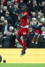 Liverpool's Sadio Mane celebrates after scoring his side's third goal during the English Premier League soccer match between Liverpool and Manchester City at Anfield stadium in Liverpool, England, Sunday, Nov. 10, 2019. (AP Photo/Jon Super)
