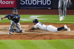New York Yankees' Rougned Odor, right, slides past Tampa Bay Rays catcher Francisco Mejia to score on a two-run single by Clint Frazier during the fourth inning of a baseball game Wednesday, June 2, 2021, in New York. (AP Photo/Frank Franklin II)