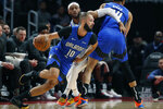 Orlando Magic guard Evan Fournier (10) drives as Detroit Pistons guard Bruce Brown defends during the first half of an NBA basketball game, Monday, Nov. 25, 2019, in Detroit. (AP Photo/Carlos Osorio)