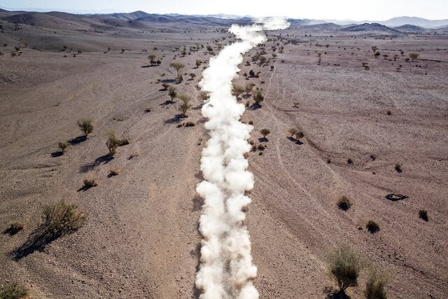 A race car kicks up a trail of dust during stage two of the Dakar Rally between Al Wajh and Neom, Saudi Arabia, on Monday, Jan. 6, 2020. (AP Photo/Bernat Armangue)