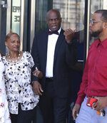 Former Nevada Senate Majority Leader Kelvin Atkinson, center, who pleaded guilty to misusing campaign funds, leaves the Lloyd D. George U.S. Courthouse after his sentencing on Thursday, July 18, 2019, in Las Vegas. Atkinson has been sentenced to 27 months in prison and fined almost $250,000 for misusing campaign funds. (Bizuayehu Tesfaye/Las Vegas Review-Journal via AP)