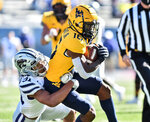 West Virginia  wide receiver Winston Wright Jr. (16) is tackled after a catch by Kansas State defensive back Jahron McPherson (31) during an NCAA college football game Saturday, Oct. 31, 2020, in Morgantown, W.Va. (William Wotring/The Dominion-Post via AP)