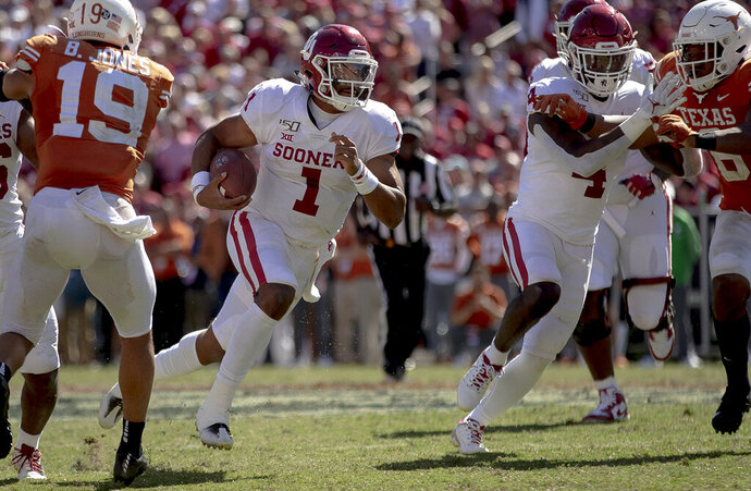 Oklahoma quarterback Jalen Hurts (1) runs the ball against Texas during an NCAA college football game at the Cotton Bowl on Saturday, Oct. 12, 2019, in Dallas, Texas. (Nick Wagner/Austin American-Statesman via AP)