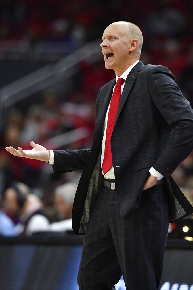 Louisville head coach Chris Mack complains about a call during the second half of an NCAA college basketball game against North Carolina Central in Louisville, Ky., Sunday, Nov. 17, 2019. (AP Photo/Timothy D. Easley)