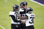 Jacksonville Jaguars quarterback Gardner Minshew II (15) and running back James Robinson (30) react after they connected for a touchdown pass against the Baltimore Ravens during the second half of an NFL football game, Sunday, Dec. 20, 2020, in Baltimore. (AP Photo/Gail Burton)