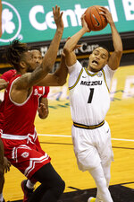 Missouri's Xavier Pinson, right, shoots past Bradley's Ari Boya, left, during the second half of an NCAA college basketball game Tuesday, Dec. 22, 2020, in Columbia, Mo. (AP Photo/L.G. Patterson)