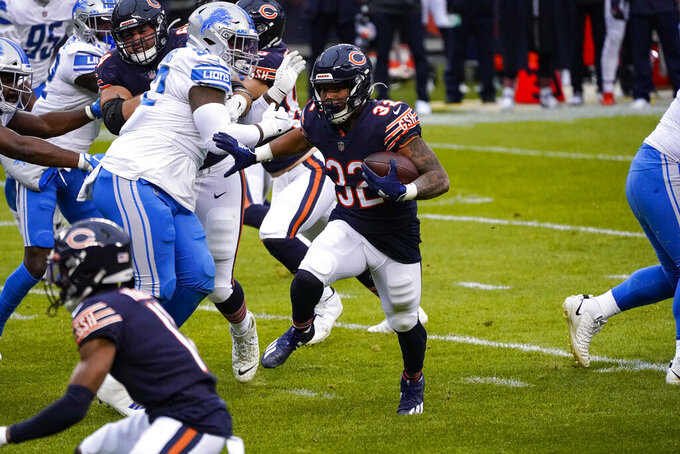 Chicago Bears running back David Montgomery (32) head for the end zone for a touchdown against the Detroit Lions in the first half of an NFL football game in Chicago, Sunday, Dec. 6, 2020. (AP Photo/Charles Rex Arbogast)