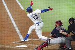 Texas Rangers' Joey Gallo strikes out in the third inning of a baseball game against the Boston Red Sox in Arlington, Texas, Saturday, May 1, 2021. (AP Photo/Louis DeLuca)