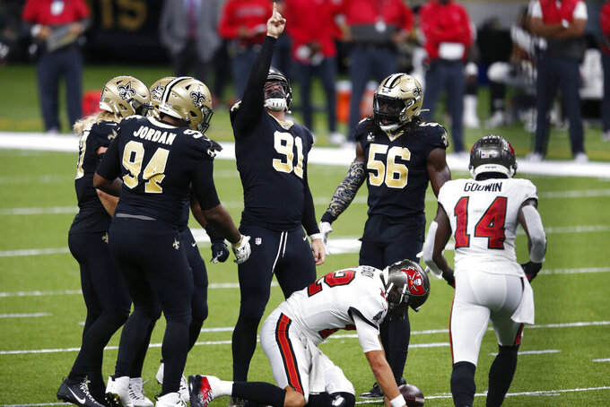 New Orleans Saints defensive end Trey Hendrickson (91) celebrates with teammates after sacking Tampa Bay Buccaneers quarterback Tom Brady (12) in the first half of an NFL football game in New Orleans, Sunday, Sept. 13, 2020. (AP Photo/Butch Dill)
