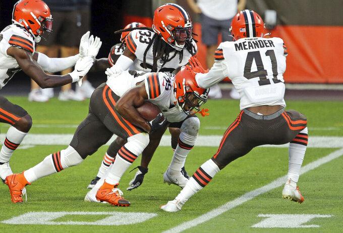 Cleveland Browns safety Jovante Moffatt (35) runs after intercepting a pass during the NFL football team's scrimmage Friday, Sept. 4, 2020, in Cleveland. (Joshua Gunter/Cleveland.com via AP)