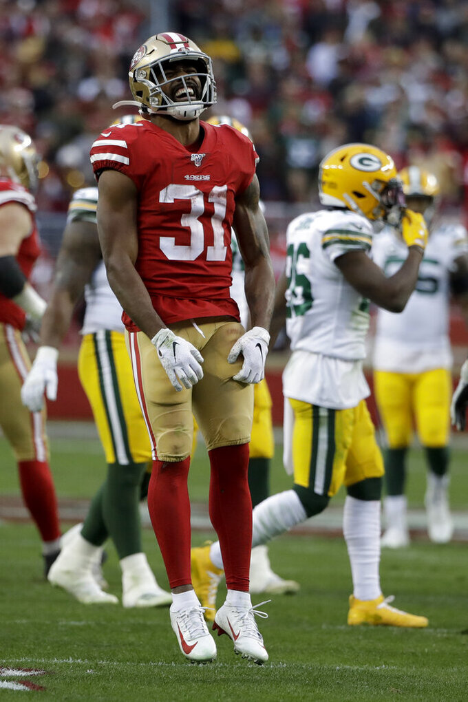 San Francisco 49ers running back Raheem Mostert celebrates after a long run against the Green Bay Packers during the first half of the NFL NFC Championship football game Sunday, Jan. 19, 2020, in Santa Clara, Calif. (AP Photo/Marcio Jose Sanchez)