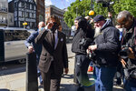Johnny Depp arrives at the High Court in London, Friday July 10, 2020.  Depp is back in the witness box at the trial of his libel suit against a tabloid newspaper that called him a