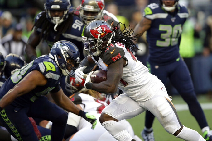 Tampa Bay Buccaneers running back Dare Ogunbowale rushes for a touchdown against the Seattle Seahawks during the second half of an NFL football game, Sunday, Nov. 3, 2019, in Seattle. (AP Photo/Scott Eklund)