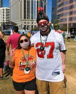 Craig Cathers, right, of Minneapolis, and Coreana Fairbanks, also of Minneapolis, pose for a photo while attending the NFL Super Bowl Experience theme park in downtown Tampa, Fla., Friday, Feb. 5, 2021. (AP Photo/Dennis Waszak Jr.)