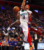 Charlotte Hornets guard Terry Rozier (3) attempts a layup as Detroit Pistons guard Bruce Brown defends during the second half of an NBA basketball game, Friday, Nov. 29, 2019, in Detroit. (AP Photo/Carlos Osorio)