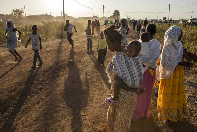 Tigray refugees who fled a conflict in the Ethiopia's Tigray region, run at Village 8, the transit centre near the Lugdi border crossing, eastern Sudan, Sunday, Nov. 22, 2020. Ethiopia's military is warning civilians in the besieged Tigray regional capital that there will be