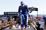 FILE - In this Nov. 5, 2017, file photo, Kyle Larson greets fans during driver introductions before the NASCAR Cup Series auto race at Texas Motor Speedway in Fort Worth, Texas. As Larsen enters his sixth season at NASCAR's top level it is clear that once he starts winning on a consistent basis he could become the biggest star in the country. (AP Photo/LM Otero, File)