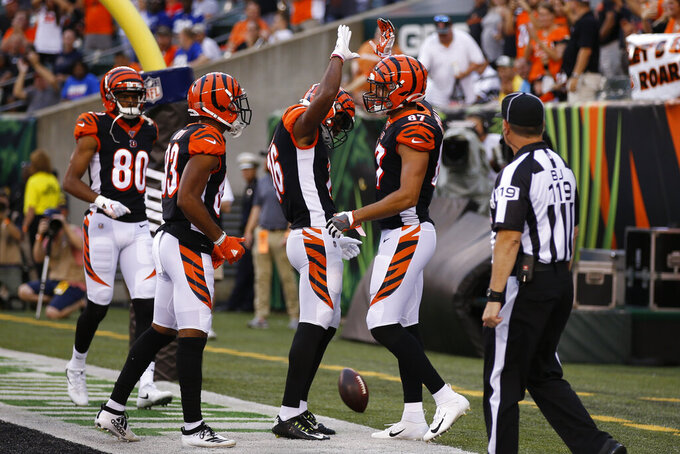 Cincinnati Bengals tight end C.J. Uzomah (87) celebrates his touchdown with teammates during the first half of an NFL preseason football game against the New York Giants, Thursday, Aug. 22, 2019, in Cincinnati. (AP Photo/Gary Landers)
