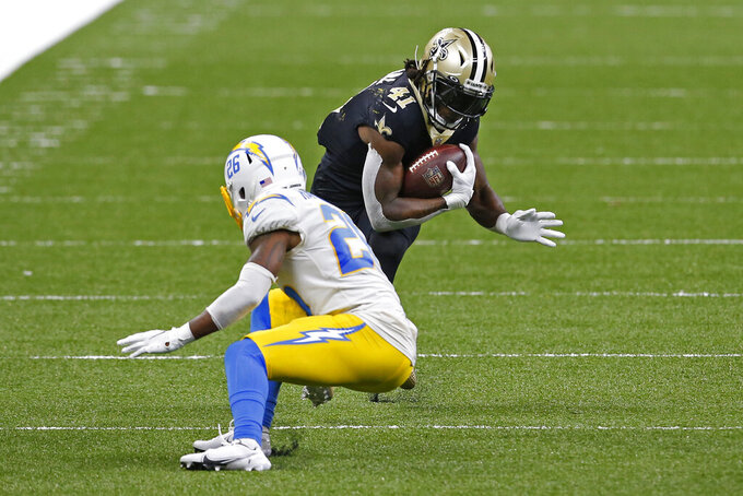 New Orleans Saints running back Alvin Kamara (41) carries against Los Angeles Chargers cornerback Casey Hayward (26) in the second half of an NFL football game in New Orleans, Monday, Oct. 12, 2020. (AP Photo/Butch Dill)