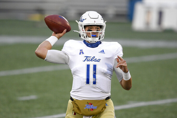 Tulsa quarterback Zach Smith (11) looks to pass during the first half of an NCAA college football game against Navy, Saturday, Dec. 5, 2020, in Annapolis, Md. (AP Photo/Nick Wass)