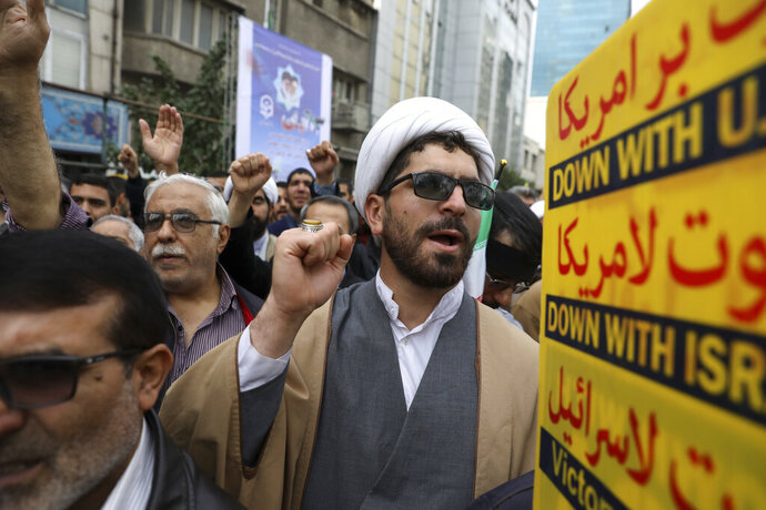 A Shiite Muslim cleric chants slogan during an anti-U.S. annual rally in front of the former U.S. Embassy in Tehran, Iran, Monday, Nov. 4, 2019. Reviving decades-old cries of